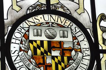 Stained glass image of university seal