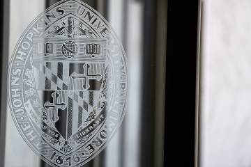 JHU seal on glass