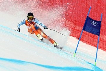 Olympic downhill skier makes a turn