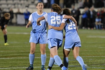 JHU teammates celebrate a goal
