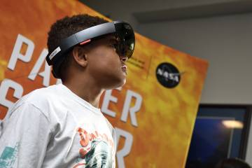 A boy wears the parker Solar Probe augmented reality headset