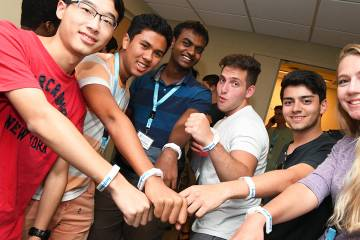 Group of students show off wearable tech device Aura Spark