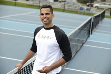 Nikhil Panu poses on a tennis court