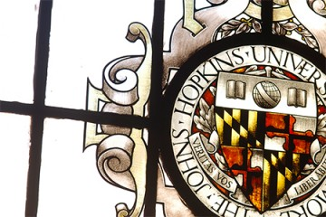 Johns Hopkins University seal in stained glass