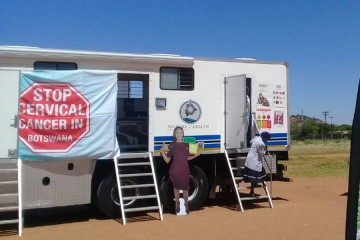 A trailer is labeled with signs reading 'Stop cervical cancer in Botswana'