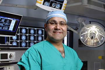 Photo of Dr. Alfredo Quinones-Hinojosa in the operating room