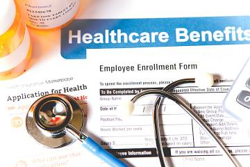 Health care forms and a stethoscope