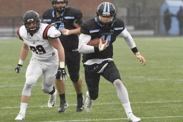 Johns Hopkins QB David Tammaro runs with the football