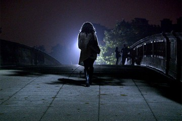 A girl walking into the darkness