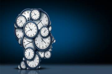 Clock faces assembled in the shape of a head