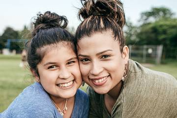 Smiling woman and daughter