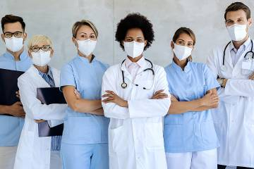A group of health care providers, all wearing medical protection masks