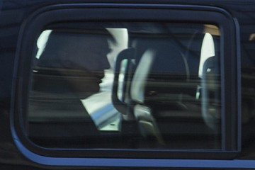 Silhouette of Donald Trump in back seat of car