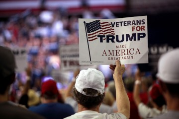 Donald Trump supporter holds sign that read 'Veterans for Trump, Make America Great Again!'