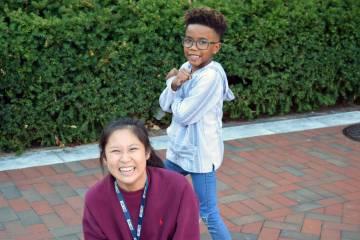 A school kid and tutor goof around