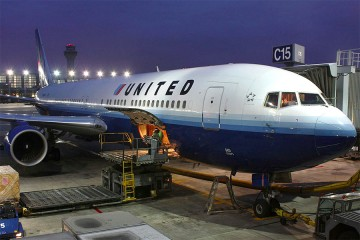 United Boeing 767-300 at gate at Chicago O'Hare International Airport under night sky