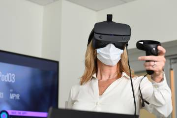 Faculty and staff test out the new VR sim equipment at the School of Nursing's Sim Center Kristen Brown