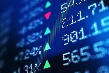 Screen showing stock market symbols