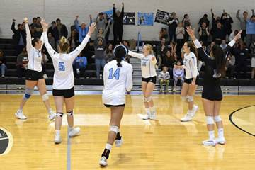 Hopkins volleyball players celebrate a point