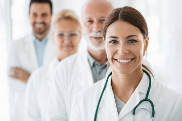 Group of four doctors looking at the camera
