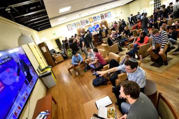 Groups of students watch election returns