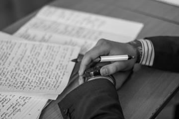 Closeup of hands writing