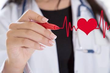 Doctor drawing ECG heartbeat chart.