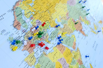 Multi-colored pins in a map of the world