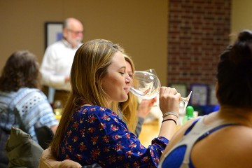 Student sips wine