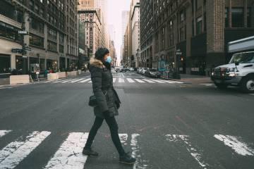 Woman in winter coat crosses street in NYC
