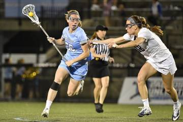 Johns Hopkins senior Ellie McNulty controls the ball vs. a Penn State defender
