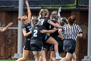 Hopkins women's lacrosse players celebrate