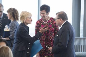 Bridget van Kralingen (left) speaks with Karen Peetz and Carey Business School Dean, Bernard Ferrari