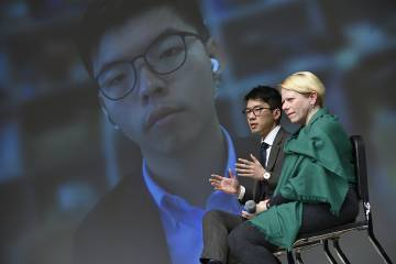 Joshua Wong and Nathan Law speak with Giovanna Maria Dora Dore, professor of East Asian studies at Foreign Affairs Symposium