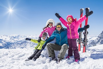 Happy-looking family of four on ski slope
