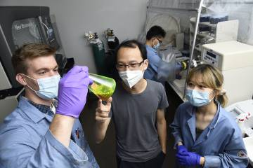 Xiongyi Huang and lab members working on a fluorescent experiment