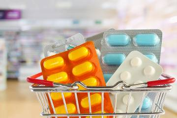 Oversized packs of pills in a shopping cart