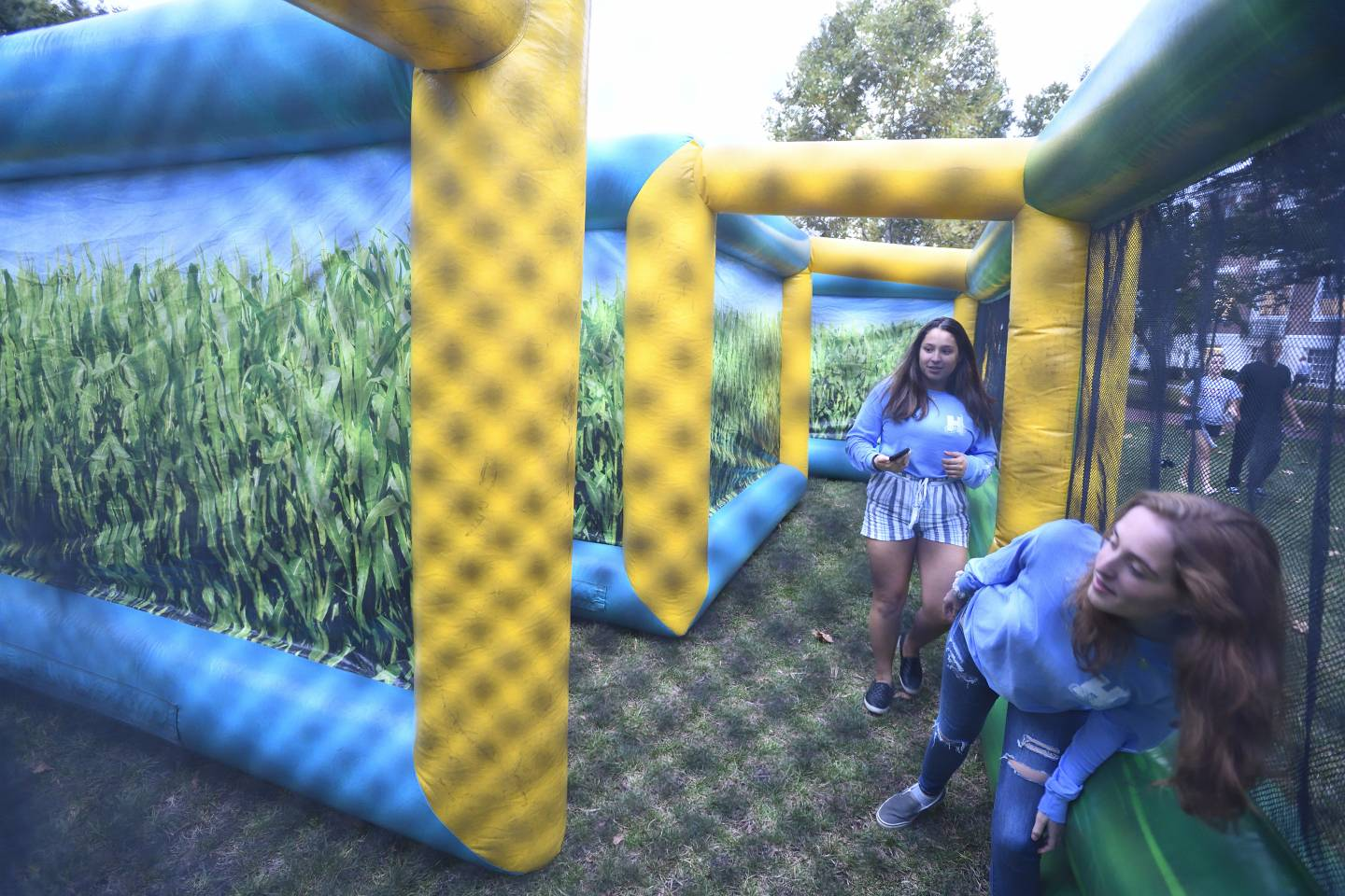 Students get lost in an inflatable corn maze