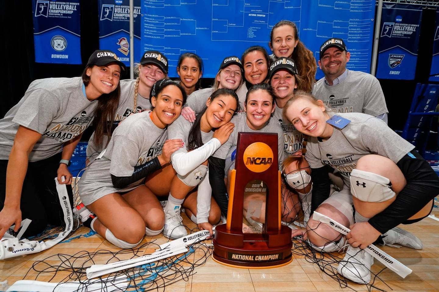 Volleyball team poses with the NCAA championship trophy