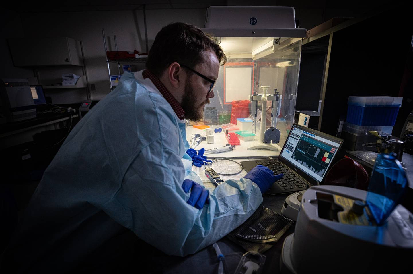 APL biologist Tom Mehoke reviews the DNA sequencing analysis of SARS-CoV-2, the virus causing COVID-19, at the molecular diagnostics laboratory at Johns Hopkins Hospital.