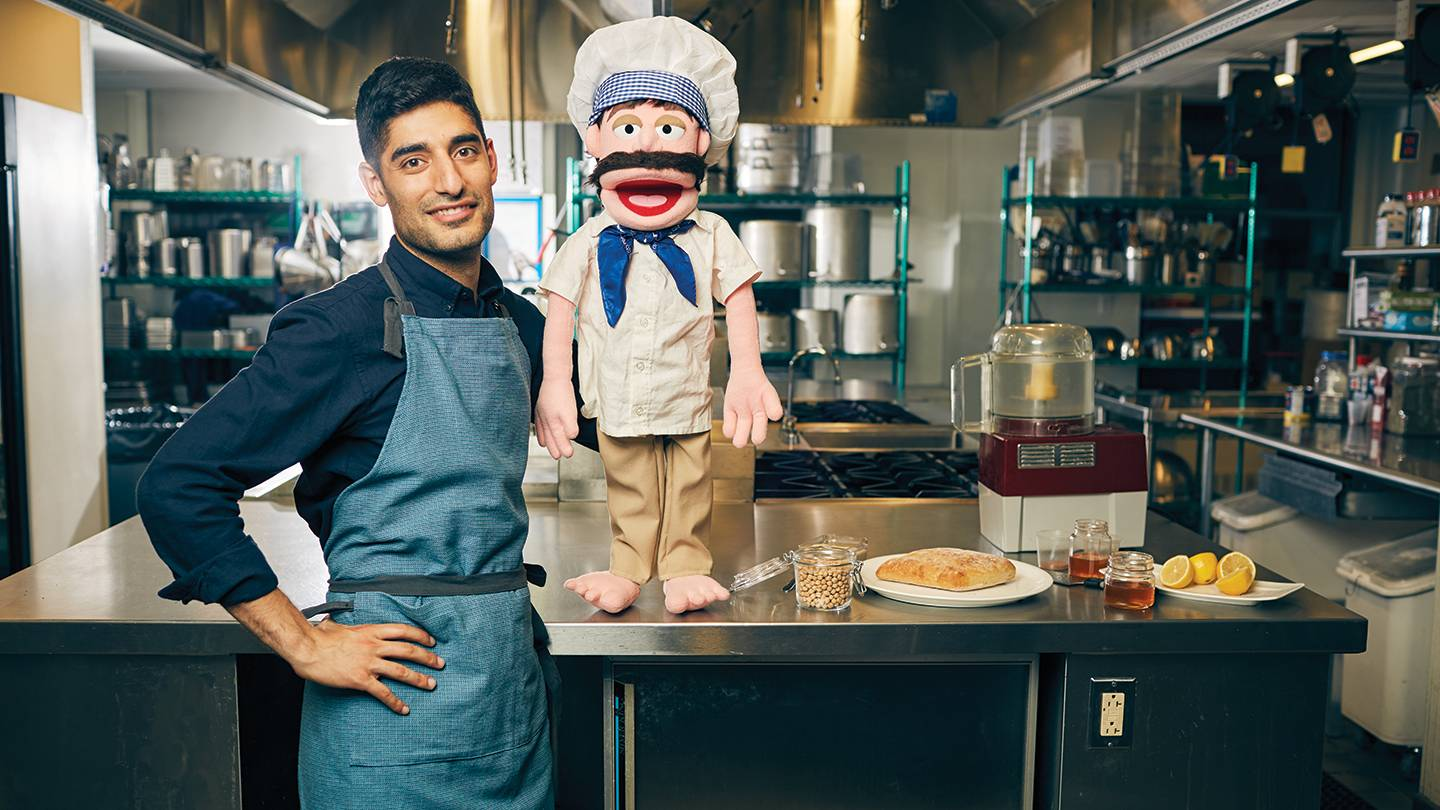 Mohammad Modarres with a puppet chef