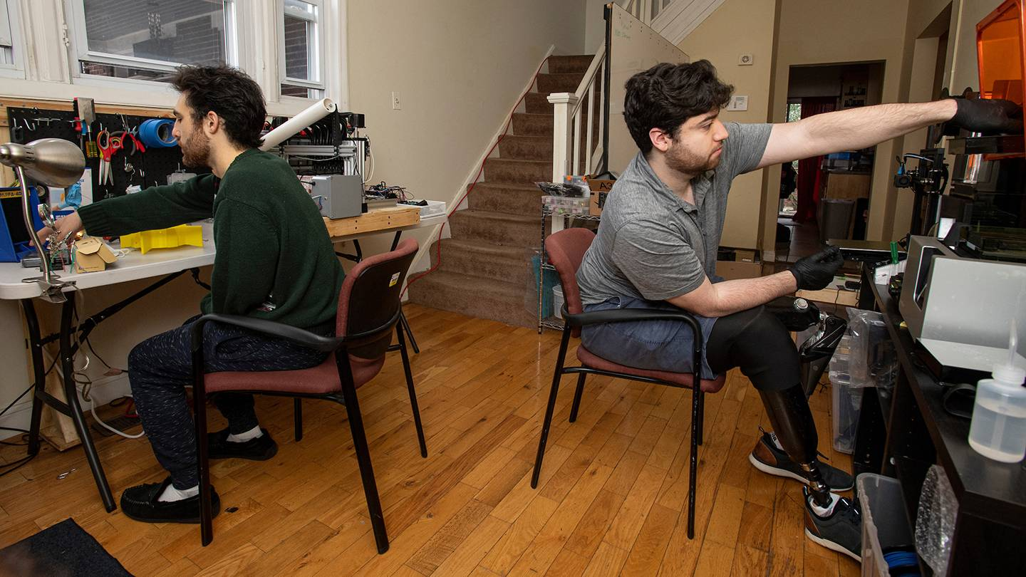 Mechanical Engineering undergraduate Mark Shifman and BME undergraduate Chris Shallal work in the makeshift engineering lab they set up in their home near campus with their housemates during the shutdown necessitated by the COVID-19 pandemic.