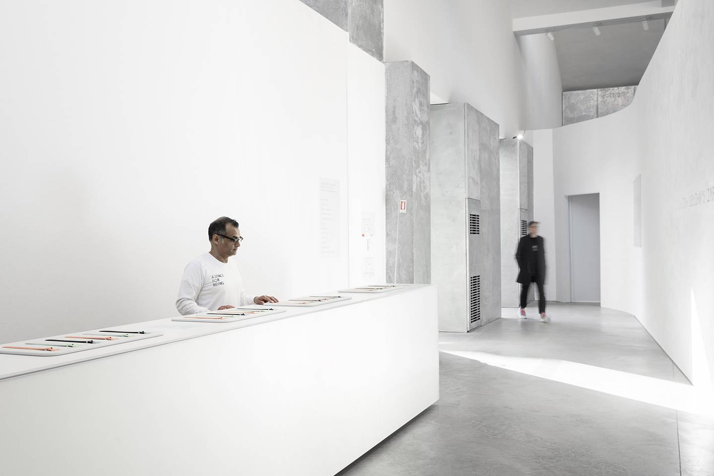 Entrance of the exhibit is stark white and unadorned