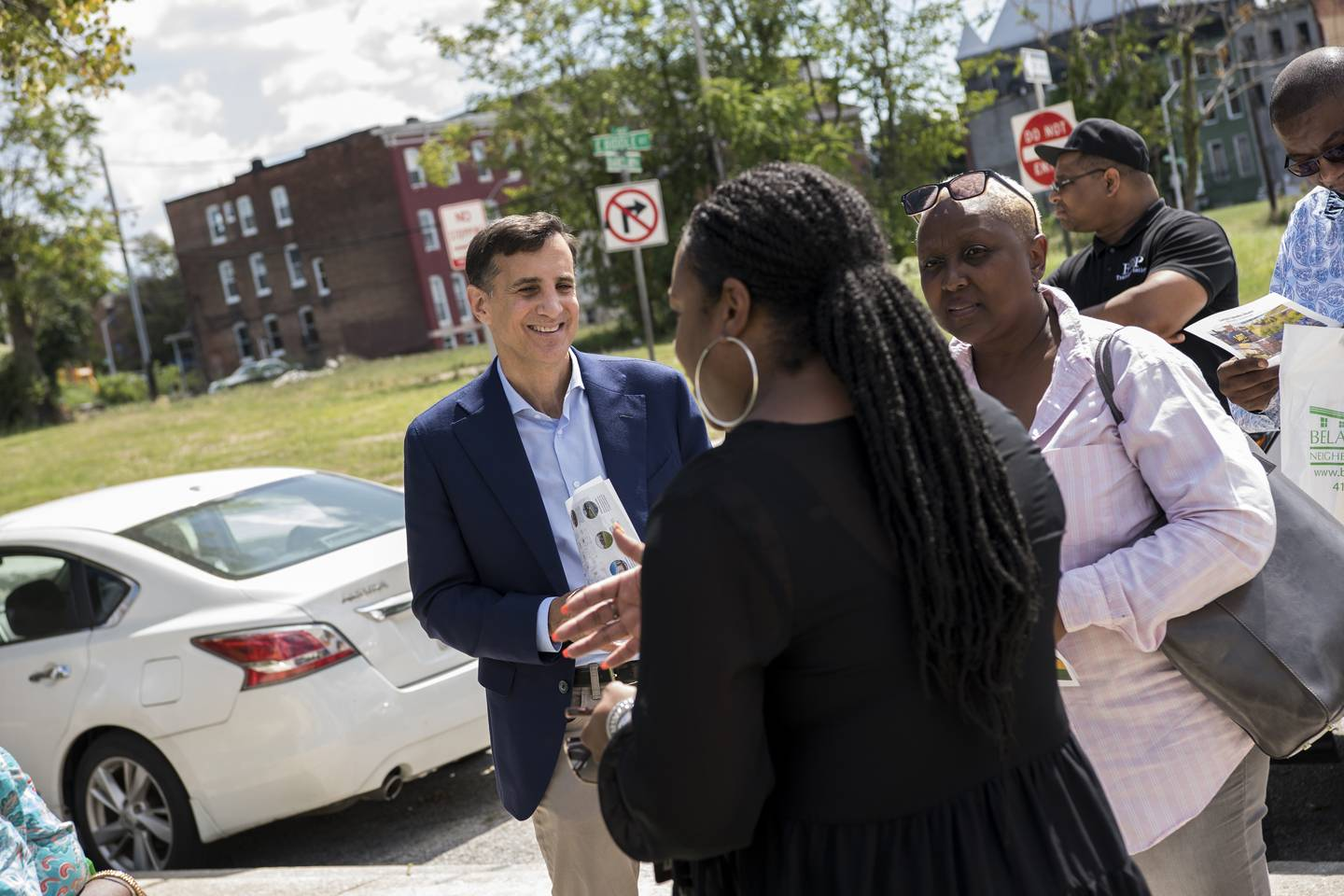 Event attendees tour the Johnston Square neighborhood