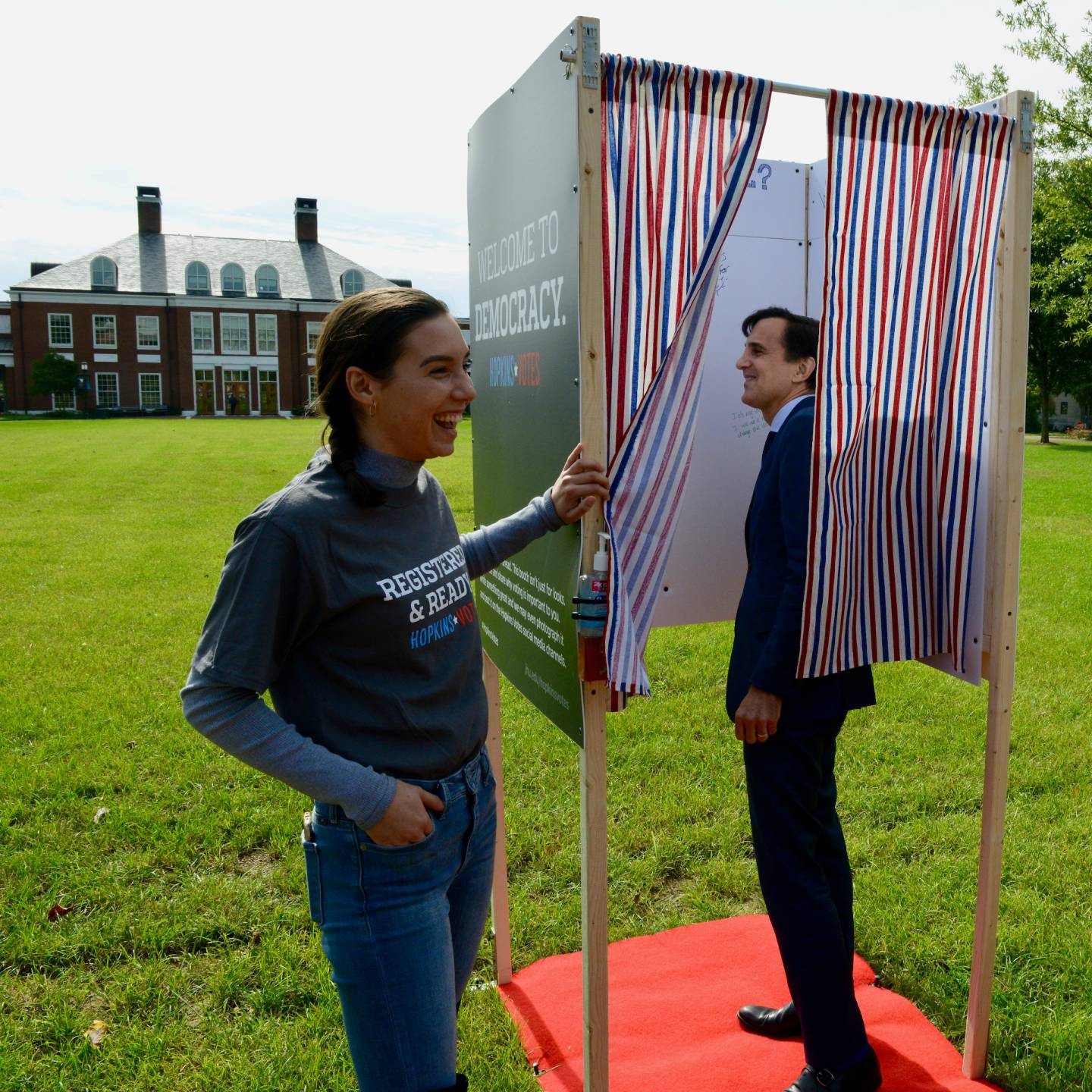 A student and Ron Daniels interact with the voter booth