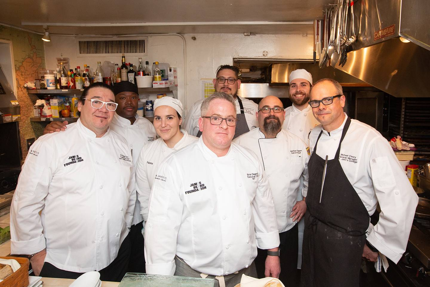 Chefs pose for a photo