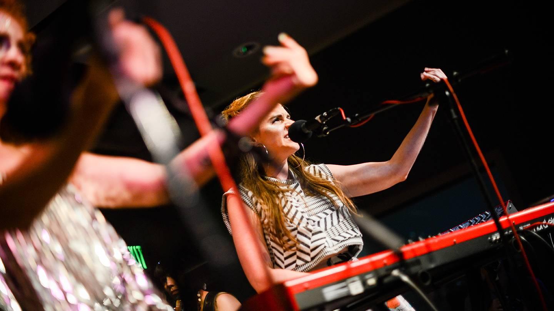 Britt Olsen-Ecker performs with Outcalls