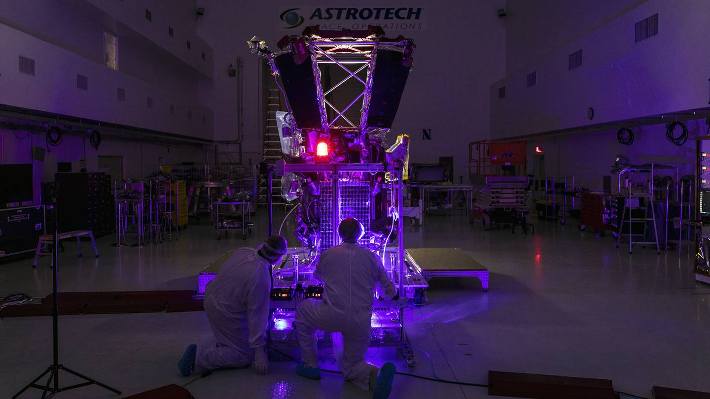 Scientists test the spacecraft with purple lasers