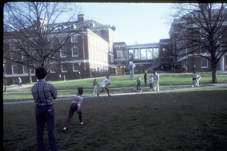 Tutors and students play baseball on Wyman Quad