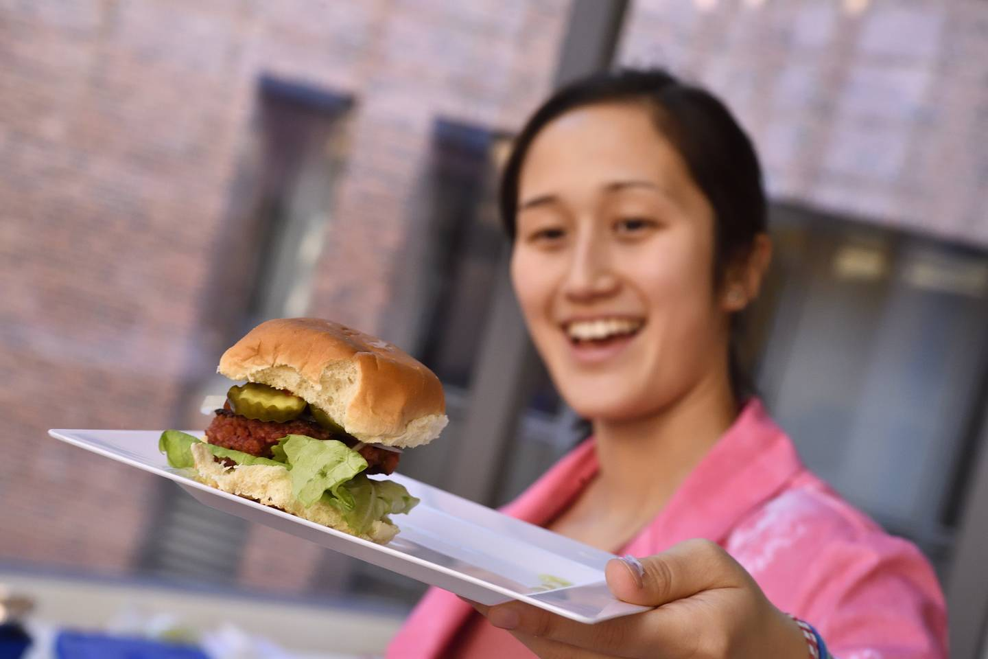 A student displays her burger slider